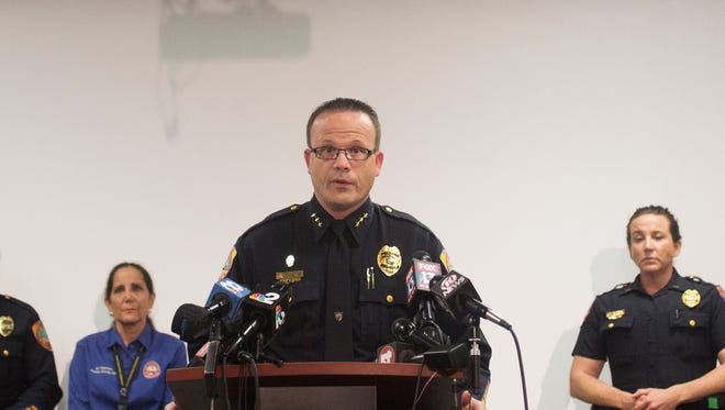 Punta Gorda police chief, Thomas Lewis, center, speaks at  a press conference Wednesda afternoon.  Mary Knowlton,73, was killed during a Chamber Police Night at the Punta Gorda Police Department.