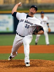 Blue Wahoos pitcher Sal Romano, (No.35) brings the heat during Tuesday night's home game against Biloxi Shuckers.