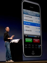 Steve Jobs checks his voice mail while introducing