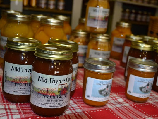 Wild Thyme Farm's produce fills shelves full of jars at Back in Thyme in downtown Port Clinton. The fruits and vegetables are canned according to Patti Wandover's personal family recipes.p