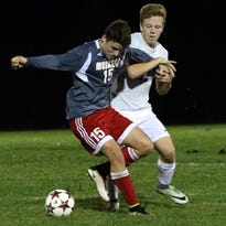 Muskego's Rade Novakovich (15) battles for position in a soccer game earlier this season. He had two goals in the Warriors' sectional semifinal victory over Oak Creek Thursday night.