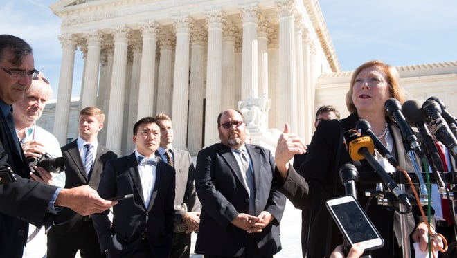Samsung's attorney, Kathleen Sullivan, answers questions outside the Supreme Court following oral argument Oct. 11.