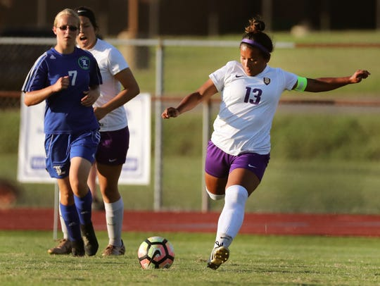 Smyrna's Brenda Cernas (13) boots the ball downfield during a 2018 match against La Vergne.