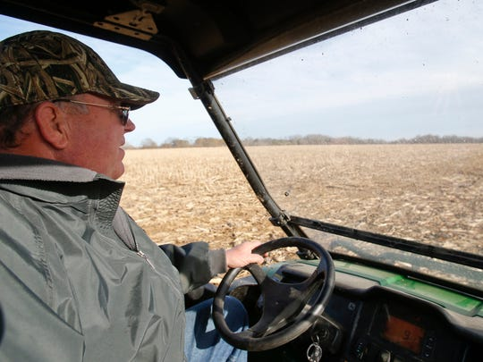 Jaymes Lester drives on his property near Port Penn in southern New Castle County on Feb. 20. His 110 acres are part of an ongoing debate related to the county's farmland preservation program.