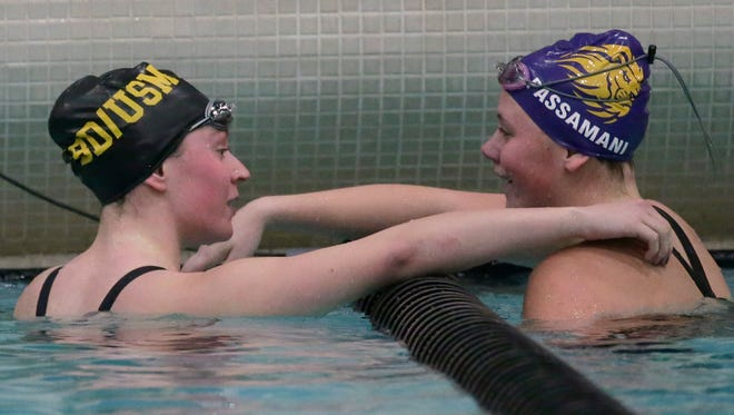 New Berlin Eisenhower's Bella Passamani  is congratulated by Brown Deer/University School's Katie Hayes after she won the 100-yard butterfly at the WIAA Division 2 girls state meet on Friday night at the UW Natatorium in Madison.