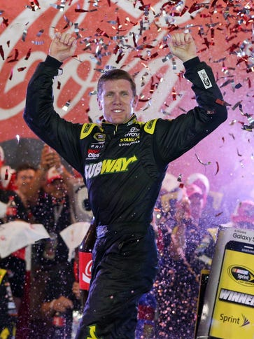 Carl Edwards celebrates after winning the Coca-Cola