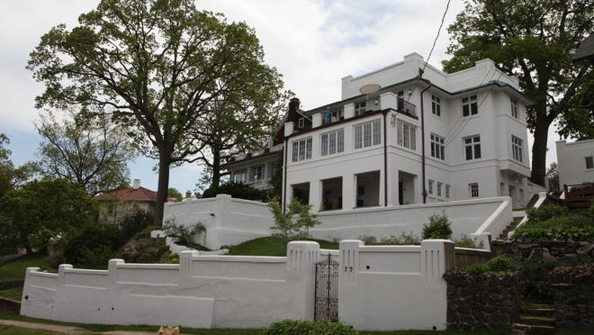 The Art Moderne mansion in the Sutton Manor neighborhood of New Rochelle is one of five private homes that will be open for the 15th annual New Rochelle House tour on May 31. Because of water damage over the years, most of the exterior stone and concrete walls have had to be rebuilt by current homeowner Heath Windcliff.