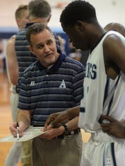 Airline head coach Chris White talks with one of his