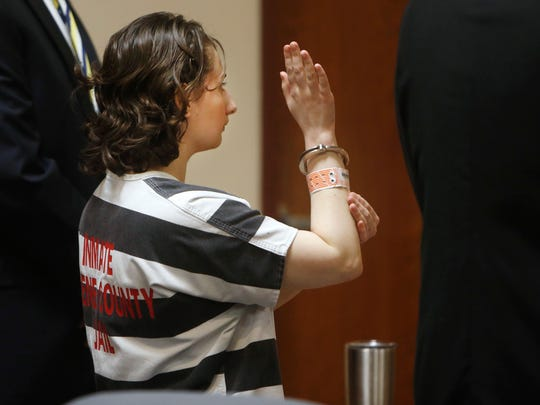 Gypsy Blanchard raises her right hand and swears an oath while pleading guilty to murder in the second degree during her court appearance on Tuesday, July 5, 2016.