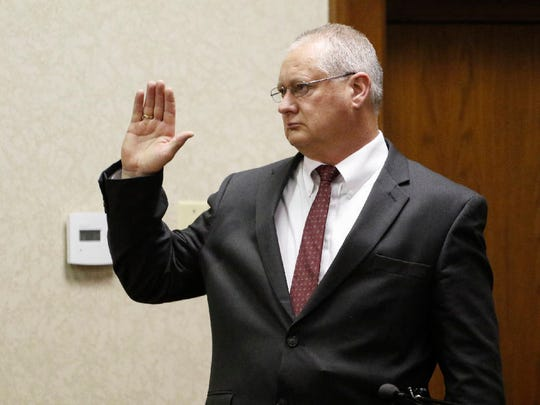 Detective Rodney Burns of the Gatlinburg Police Department is sworn as a witness during a preliminary hearing for the Ooltewah High School basketball coaches and the school's athletic director in Hamilton County Juvenile Court.