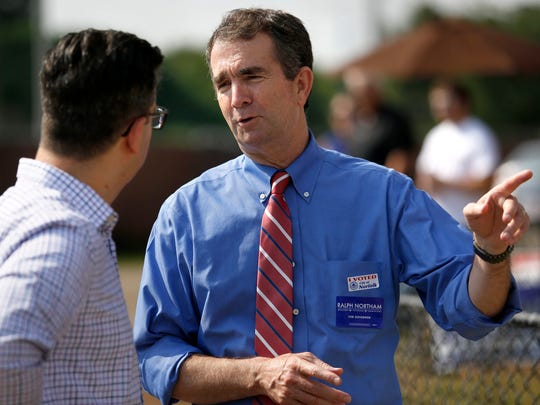 Lt. Gov. Ralph Northam greets voters and supporters at the Larchmont Elementary School polling place on Election Day in Norfolk, Va., June 13, 2017.
