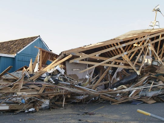 AFTER SANDY: A longtime staple in Sea Bright, Donovan's Reef, on Ocean Avenue, was reduced to mostly timber. The new Donovan's will be an elevated structure, raised 17 feet high.