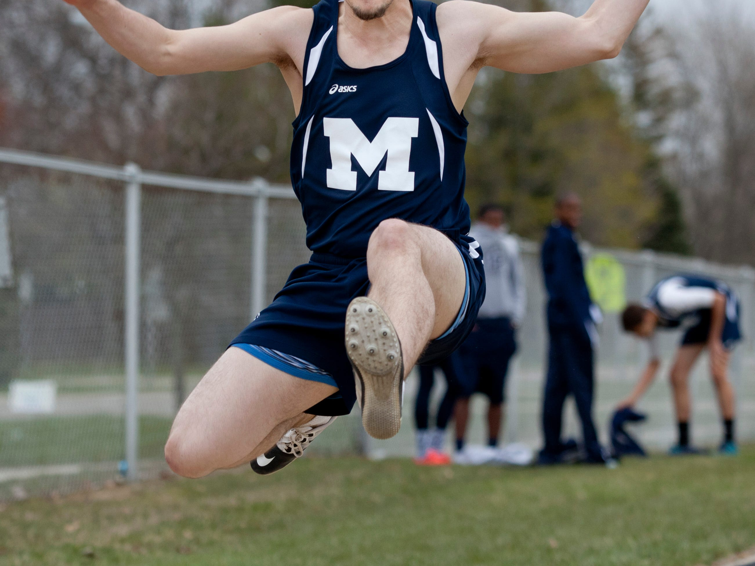 Marysville senior Jared McGeary competes in the long jump during a track meet Thursday, April 30, 2015 at Marysville High School.