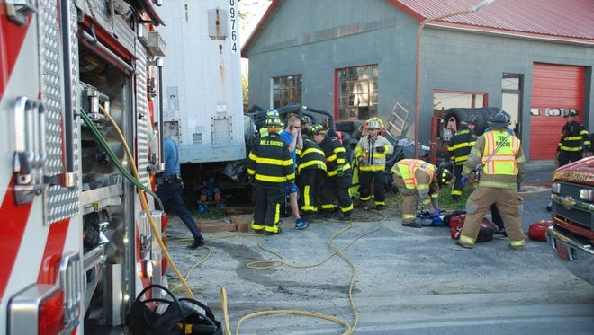 The Millsboro Fire Company and other responders extract passengers from a jeep that crashed into a parked semi-trailer Thursday, June 9.
