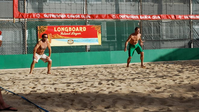 From left, Conrad and Keith Jones participate in the annual Hawaii Dinosaur Tournament at the Outrigger Canoe Club on Oahu. The brothers instruct beach volleyball locally at Franklin Beach House.