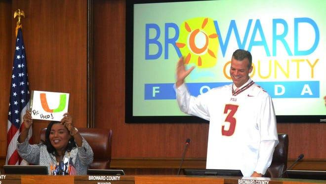 Broward County Mayor Marty Kiar does the tomahawk chop at Tuesday's meeting of the Broward County Commission.