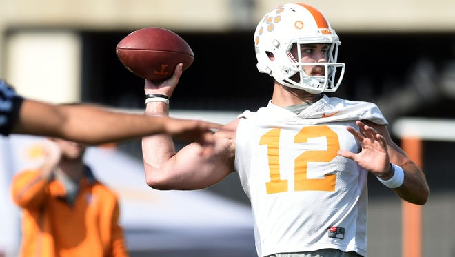 Quinten Dormady (12) participates in a drill during University of Tennessee's first spring practice Tuesday March 21, 2017.