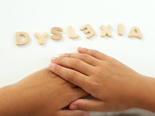 hands of a girl form the word dyslexia