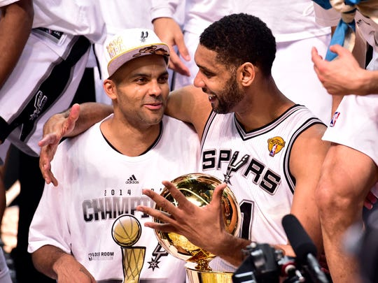 San Antonio Spurs guard Tony Parker (9) and San Antonio Spurs forward Tim Duncan (21) celebrates after game five of the 2014 NBA Finals at AT&T Center. The Spurs beat the Heat 104-87 to win the NBA Finals.