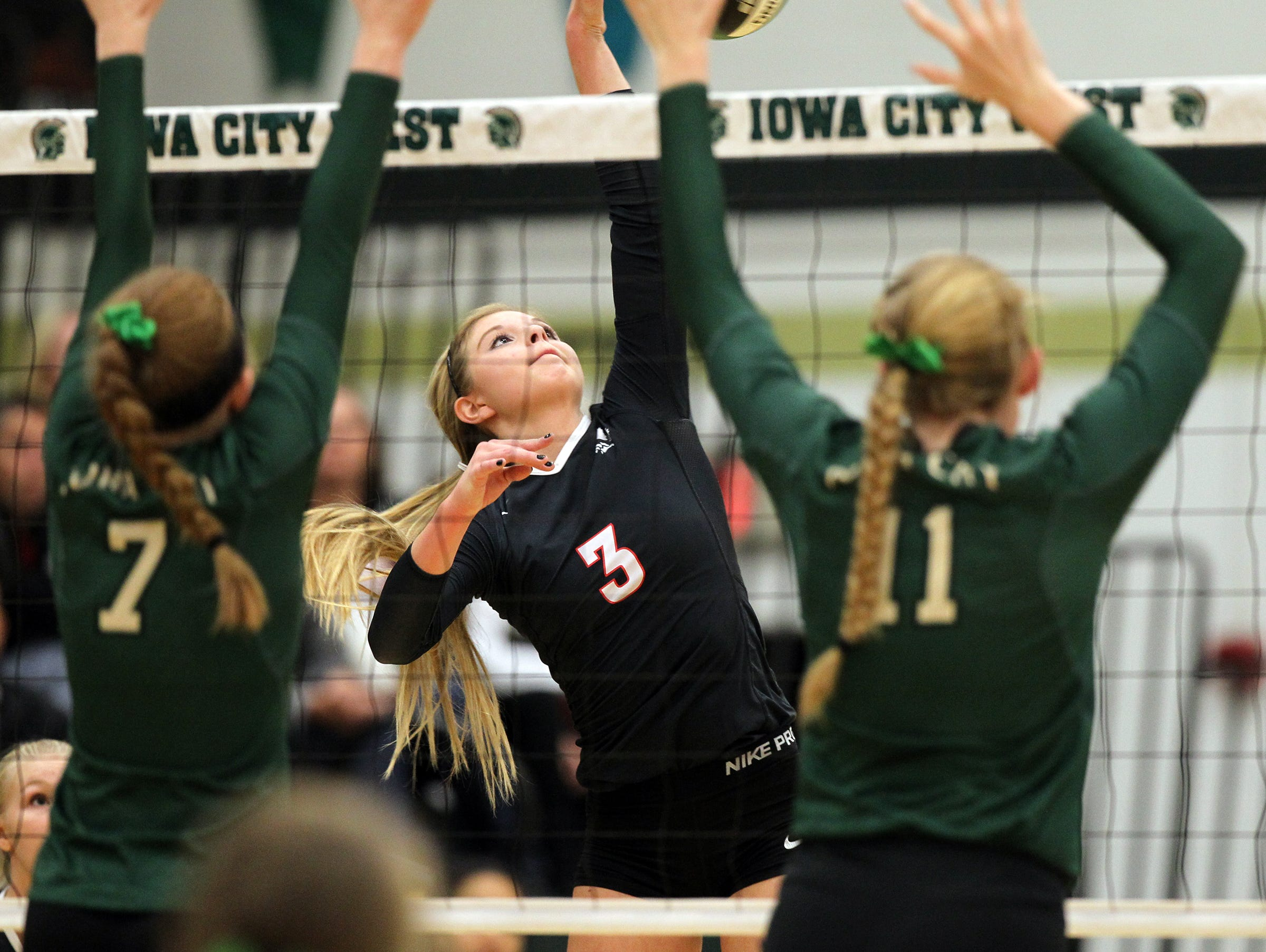 City High's Alexa Aldrich-Ingram goes for a kill during the Little Hawks' regional semifinal game at West High on Thursday, Oct. 29, 2015.