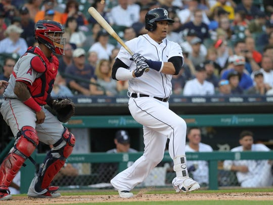 Detroit Tigers DH Victor Martinez singles against the