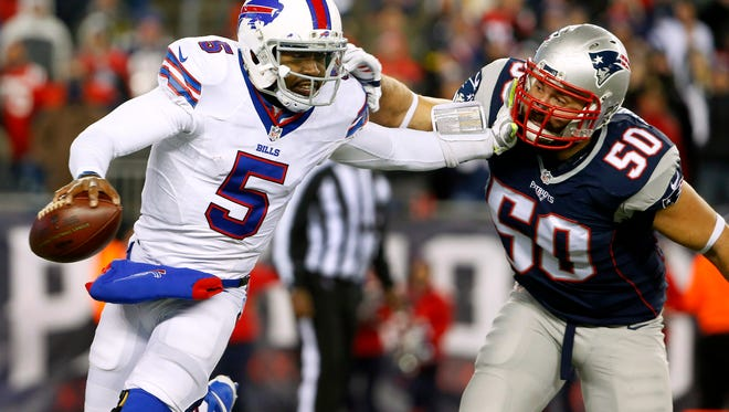Buffalo Bills quarterback Tyrod Taylor (5) tries to break free from New England Patriots defensive end Rob Ninkovich (50) during the second half at Gillette Stadium Monday night.