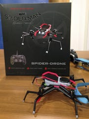A remote-controlled Spider-Man drone is displayed during a news conference in Boston, where the child safety group World Against Toys Causing Harm, or W.A.T.C.H., released its annual holiday list of the ten most hazardous toys.