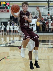 Station Camp's Chase Freeman drives to the hoop against