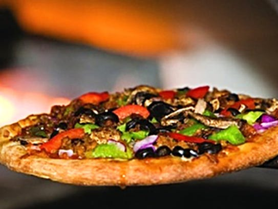 Pizzas are fire-baked in a brick oven at BRK Pizza
