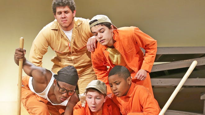 "The boys of Camp Green Lake (clockwise from top left: Brooks Blackwood, Calvin Wilner, Jarhon Hill, Michael Cunningham, Elvin Soe) find treasure in ""Holes,"" Feb. 24-Mar. 12 at the Des Moines Community Playhouse. Photo by Steve Gibbons."