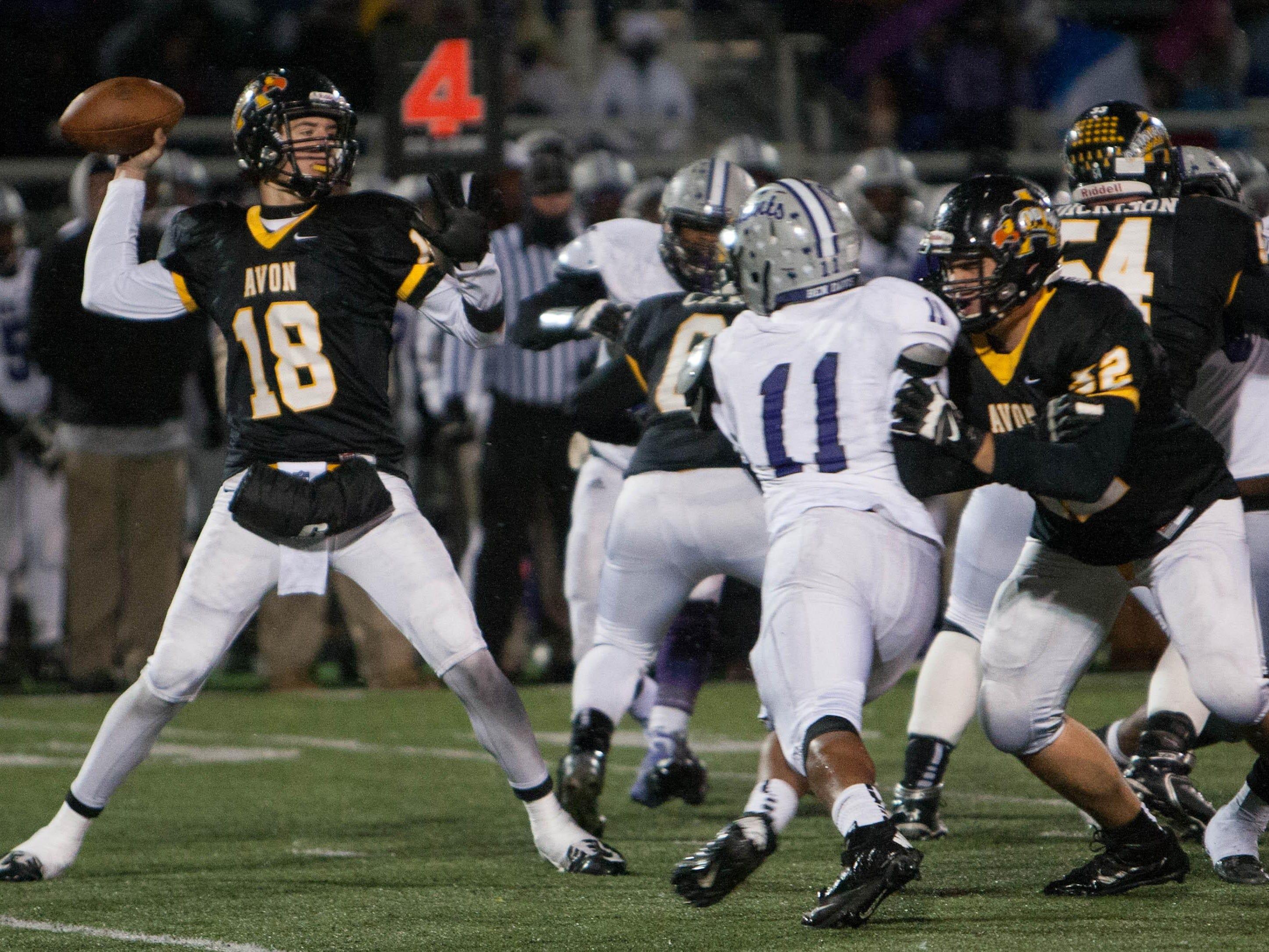 Avon quarterback Brandon Peters throws a pass against Ben Davis during sectional action at Avon, Oct. 31, 2014. The teams meet in Week 2 of the regular season.