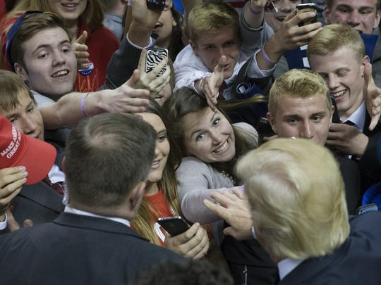 Attendees react Monday as Republican presidential candidate