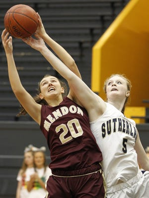 Mendon's Erin Lyons (20), left, and Sutherland's Caitlin Ryan battle for a rebound during the 2010 Rainbow Classic.