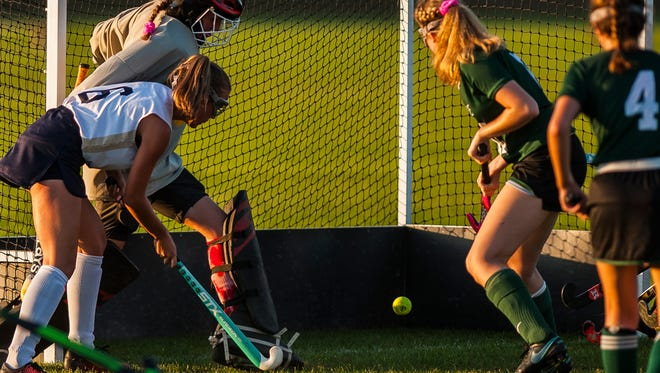 Rice keeper Emily Rachek deflects a shot from Essex #6 Hannah Neddo for the save during their field hockey game at Essex High School on Monday night, Sept. 25, 2017.