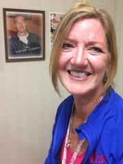 Kim Griner Heinz's office at Moundview Memorial Hospital in Friendship includes running photos, posters and a portrait of her son, Eric.