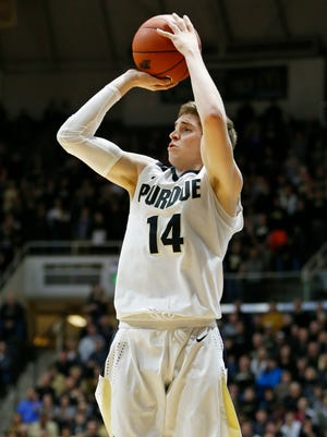 Ryan Cline with a three-point shot from the corner against Northwestern Tuesday, February 16, 2016, at Mackey Arena. Purdue defeated Northwestern 71-61.