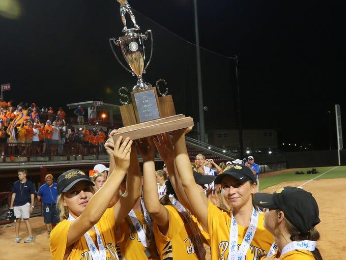 Crescent High School softball players hold up a runner-up