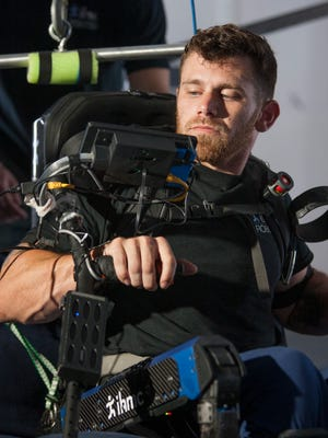 Paralyzed Pace High grad and pilot Mark Daniel adjusts the Mina v2 exoskeleton developed by the Institute for Human & Machine Cognition (IHMC) before completing an obstacle course at the IHMC facility in Pensacola on Wednesday, September 28, 2016.  Daniel and the IHMC team will be competing at the Cybathlon competition in Zurich, Switzerland, on October 8th.