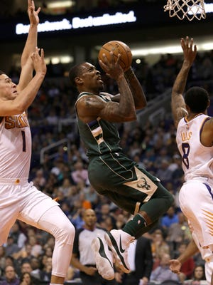 Bucks guard Eric Bledsoe soars to the basket vs. the Suns on Wednesday night in Phoenix.