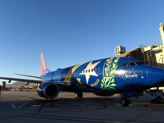 A Southwest Airlines plane, loaded with Native American veterans bound for Washington D.C. on an Honor Flight, prepares to pull back from the gate at the Reno-Tahoe International Airport in Reno on Nov. 10, 2016.