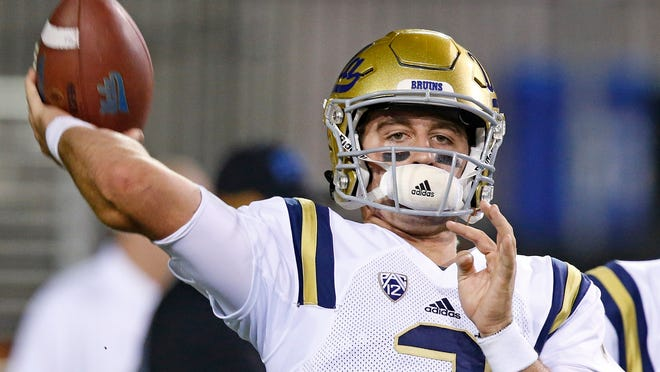 FILE - This Oct. 8, 2016 file photo shows UCLA quarterback Josh Rosen warming up prior to an NCAA college football game against Arizona State in Tempe, Ariz. Rosen will try to lead a turnaround for the Bruins. Rosen has the type of talent that championship teams are built around, but the Bruins haven't provided him much stability. A breakthrough season by Rosen could make UCLA one of the top turnaround teams in the country, give job security to coach Jim Mora and turn Rosen into a top-five pick in next year's NFL draft.  (AP Photo/Ross D. Franklin)
