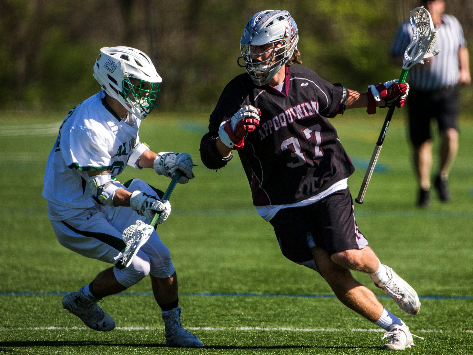 Appoquinimink's John Dunbar (right) works against Archmere's David Dewees (left) in the first quarter of Appoquinimink's 13-12 win over Archmere at Archmere Academy on Wednesday afternoon.