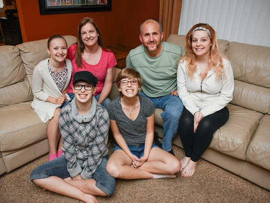 Foster parents Jim and Jackie Feiler with some of their family members Alexis Feiler, 12, left to right, twins Camille and Salena Salazar, 19, and Alyshia Hindi, 19, Wednesday, June 15, 2016, at their home in St. Augusta.