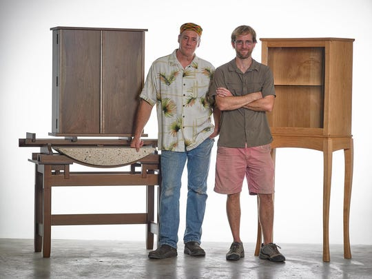 Master artist (wood furniture) Scott DeWaard from Walland, Tenn., left, and apprentice Stephen Shankles from Maryville, Tenn., stand next to the work they completed during Tennessee Craft's Master Artist Apprentice Program.