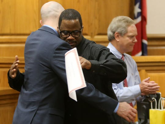Heath Goff, left, hugs Michael Robinson after Robinson spoke during the Life's Healing Choices program graduation in Judge Don Allen's courtroom at the J. Alexander Leech Criminal Justice Complex, on Friday, July 15, 2016.