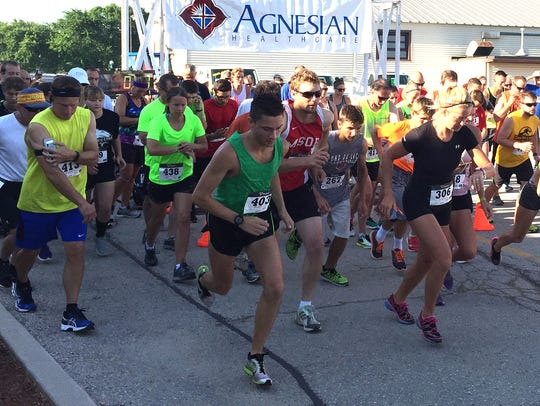 Runners take off from the starting line of the seventh