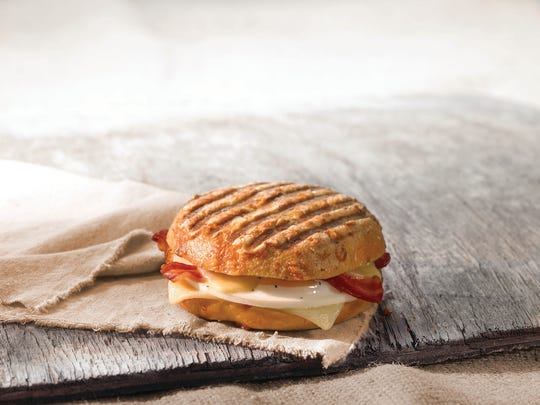 The egg, cheese and bacon on an Asiago bagel breakfast sandwich at Panera Bread.