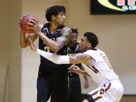 Midwestern State's Brandon Neel guards Angelo State's Prince Foster Thursday, Dec. 8, 2016, in D.L. Ligon Coliseum at MSU. Angelo State defeated Midwestern State 75-72.