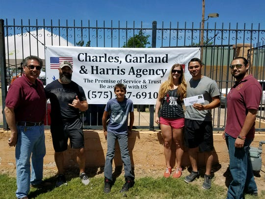 The winners of the Our American  Hero obstacle course stand with the race's sponsors on Saturday afternoon.