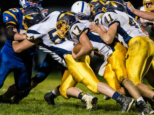 Elco's Braden Bohannon fights for a first down as Northern Lebanon defeated Elco 49-20 on Friday night.